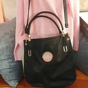 Black bag, great purse, very roomy
